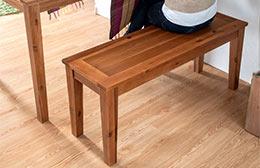チーク材のような色合いのナチュラル系2人掛けベンチ